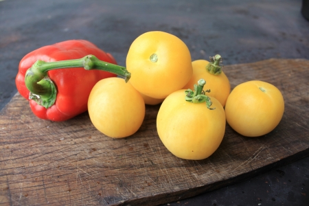 Beautiful yellow tomatoes and red bell pepper photo
