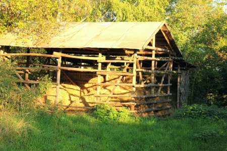 wooden barn with hay in autumn photo