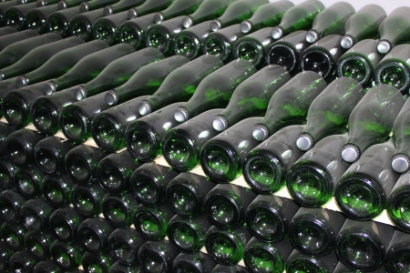 mellowness: stacked up wine bottles in the cellar
