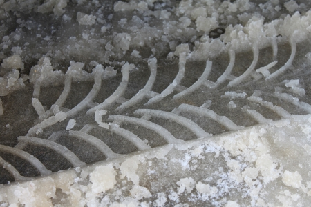 Car track in the snow close-up photo
