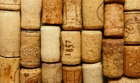 many different wine corks in the background photo