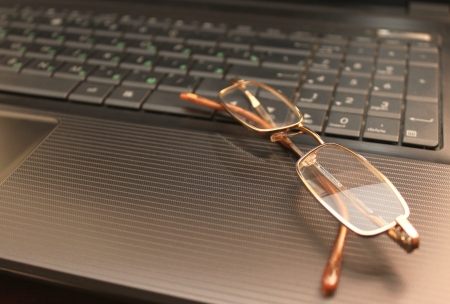laptop keyboard and glasses photo