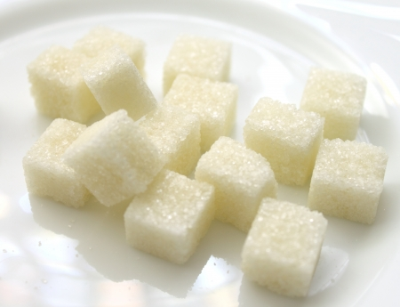 fine cane: close up of sugar cubes on white plate