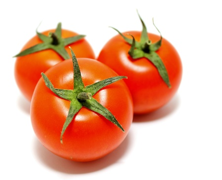 ripe tomatoes on white background Stock Photo