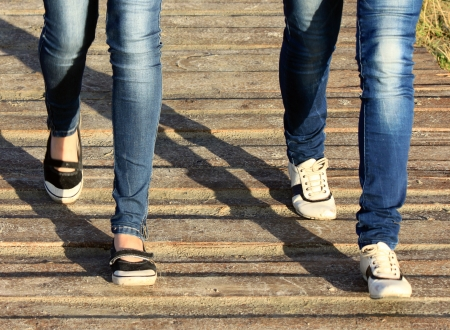 teen feet: Close-up of female feet in sneakers running outdoors