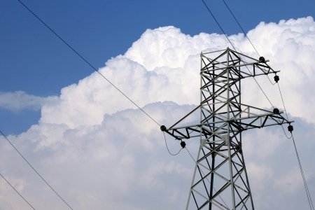 High-voltage power transmission tower in blue sky background Stock Photo - 21494609