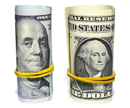 one hundred dollars: One hundred dollars and one dollar closeup on white background Stock Photo