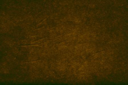 bronzed: dark abstract background, texture of wet paper