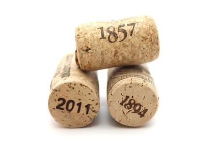 wine making: bottle corks  with dates isolatedisolated on white background