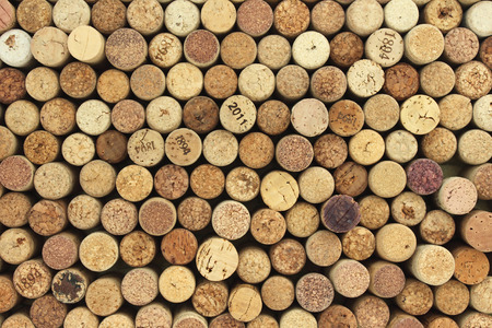 multiple stains: many different wine corks in the background
