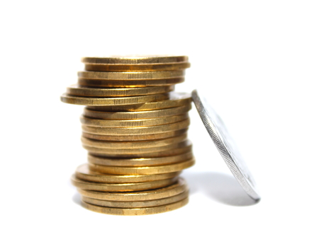 Concept Success in Business with Stack of Gold Coins isolated