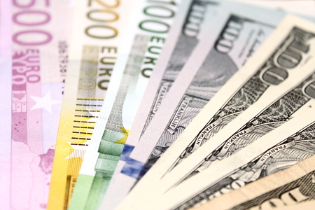 one hundred euro banknote: Background of euro and dollar bills. Shallow focus. Stock Photo