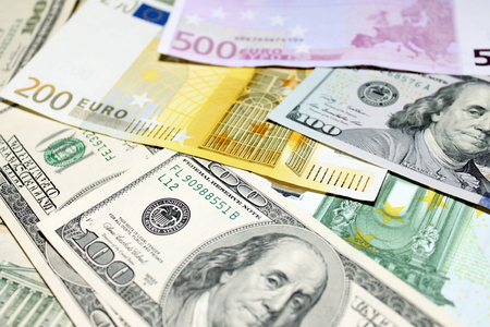 Background of euro and dollar bills. Shallow focus. photo