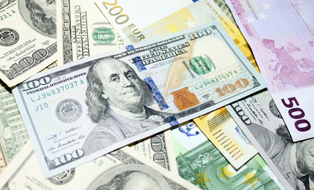 two us dollar: Background of euro and dollar bills. Shallow focus. Stock Photo