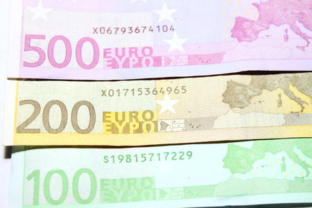 one hundred euro banknote: One hundred two hundred and five hundred euro bills closeup. Shallow focus.
