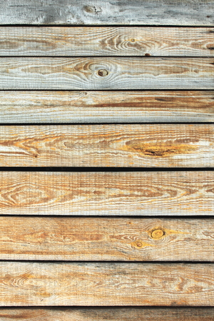 wood floor: Wooden wall texture, gray unpainted wood background with knots and nails. Vertical photo.