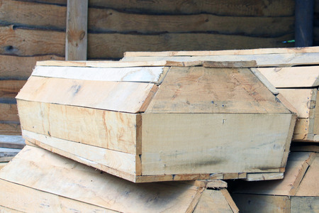 dolor: wooden coffins in stock close up