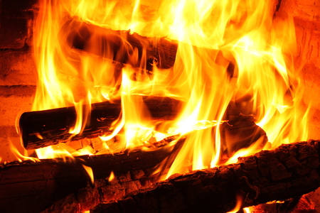 fireplace: Fire in burning fireplace in winter close-up Stock Photo