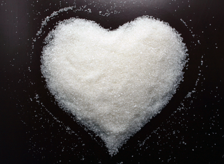 white sugar: Beautiful Sugar heart. Background Valentines Day. Valentines day ideas. Valentines day cards. Stock Photo