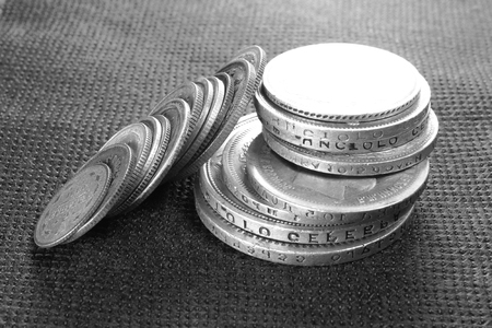 silver coins: Several ancient silver coins close-up, black and white photo Stock Photo