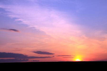 reveille: Sunset sky background. Beautiful sky. Landscape. Sunny sunset in a field. Stock Photo