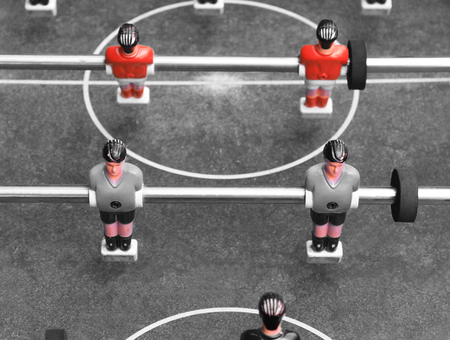 foosball: Vintage foosball. Black and white photo with elements of red color. Stock Photo