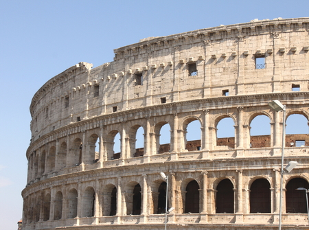 europe closeup: Great Colosseum in Rome, Italy, Europe. Roman Coliseum close-up with clear blue sky.