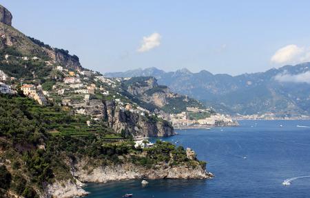 italian architecture: Beautiful landscape with sea, rocks and traditional Italian architecture at sunset. Amalfi Coast, Italy. Stock Photo