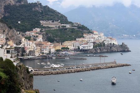 italian architecture: Beautiful landscape with sea, rocks and traditional Italian architecture at sunset. Italy. Stock Photo