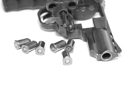 Revolver with bullets close-up isolated on white background  black and white photo in a retro style Stock Photo