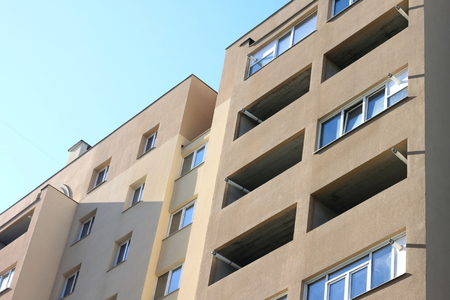 Facade of a beautiful multi-storey modern building with windows and balconies close-up