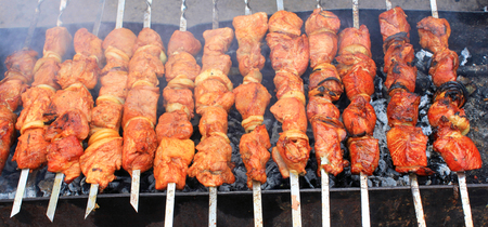 Delicious red meat on the grill during the preparation of shish kebab