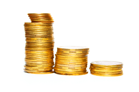 uk money: Stack of gold coins isolated on white background close-up