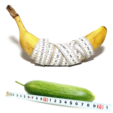 Abstract photo of a banana in form of a large male penis with good potency and cucumber in form of a large male penis with bad potency isolated on white background Imagens