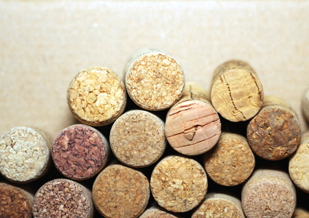 Close up of wine corks on brown paper background