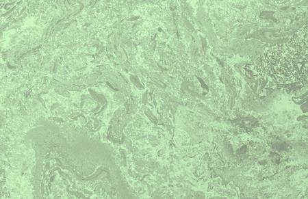 Abstract blurred green background with elements of spreading green paint and with effect of marble texture