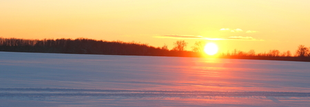 Winter evening at sunset in cold weather