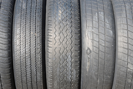 worn out bald old car tire closeup