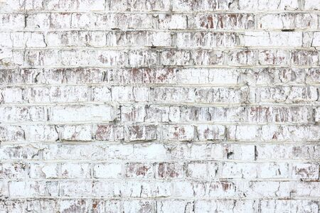 Old wall made of red brick, painted white in loft style for modern designer interior of room, bar or restaurant Stock fotó