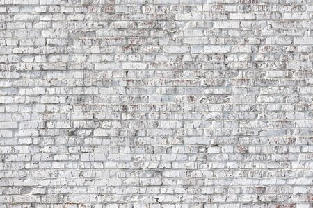 Old wall made of red brick, painted white in loft style Stock fotó