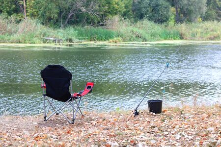 sports summer fishing with one rod and comfortable folding tourist chair Stock fotó