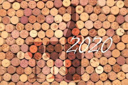 Abstract background of used old wine corks with silhouette of wine bottle and wine glasses as basis for menu or advertising in bar or restaurant 版權商用圖片