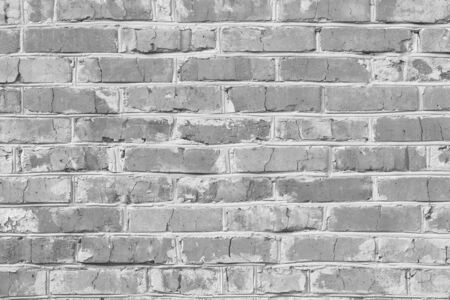 Black and white photo with image of brick wall made of old bricks with different textures