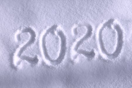 Abstract Christmas photo for beautiful Christmas card with background inscription 2020 on real white snow in winter in cold weather