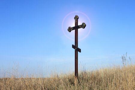 Christian cross on blue sky background