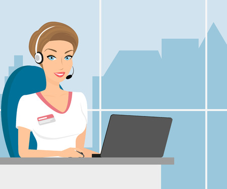 Female call centre operator with headset sitting in the office