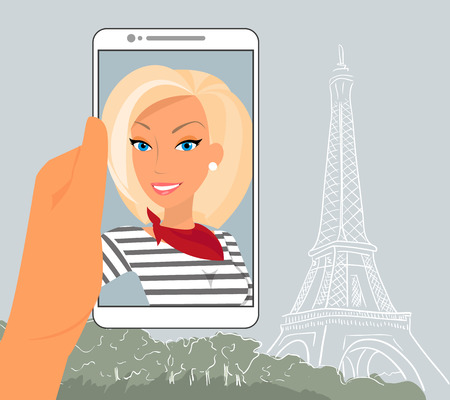 Blond woman is showing her photo in Paris displayed in smartphone.