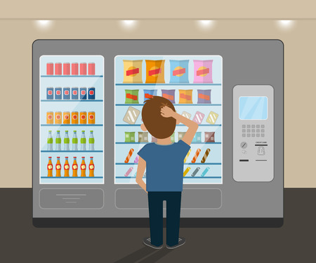 decisions: Young man is choosing a snack at vending machine