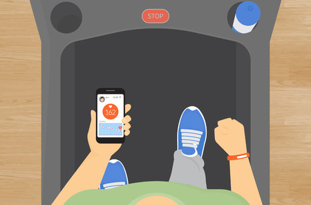 treadmill: Man running on a treadmill and getting information of his pulse rate using mobile app for sport wristlet