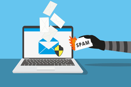 Email protection from spam. Human hand holds burning spam letter